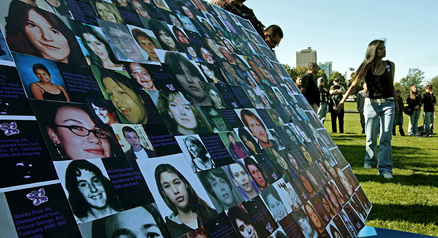 Photographs of missing or murdered women from British Columbia are displayed during a Sisters in Spirit vigil to honor the lives of missing and murdered Aboriginal women in Vancouver, B.C., in 2009.