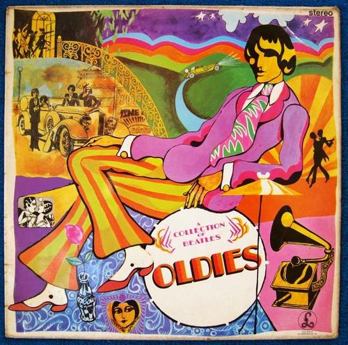 The cover of the A Collection of Beatles Oldies (But Goldies) LP. The cover is illustrated, psychadelic, and very colorful. Most prominent is a man with a mop top haircut sitting across the cover, wearing a colorful outfit. In the surrounding drawing, a road winds up towards the top of the cover, with a car with headlights lit traveling up it. The car looks ready to drive straight into the man's head any second.