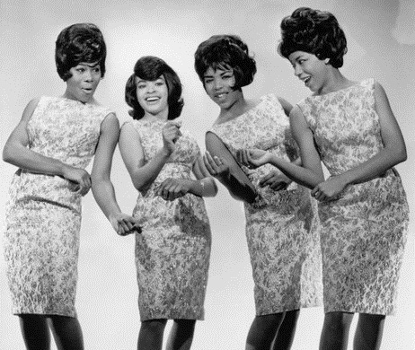 A black and white photo of the Marvelettes (minus Juana Cowart) posing for the camera