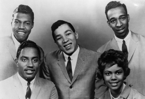 An early black and white photo of the Miracles with Smokey Robinson at center